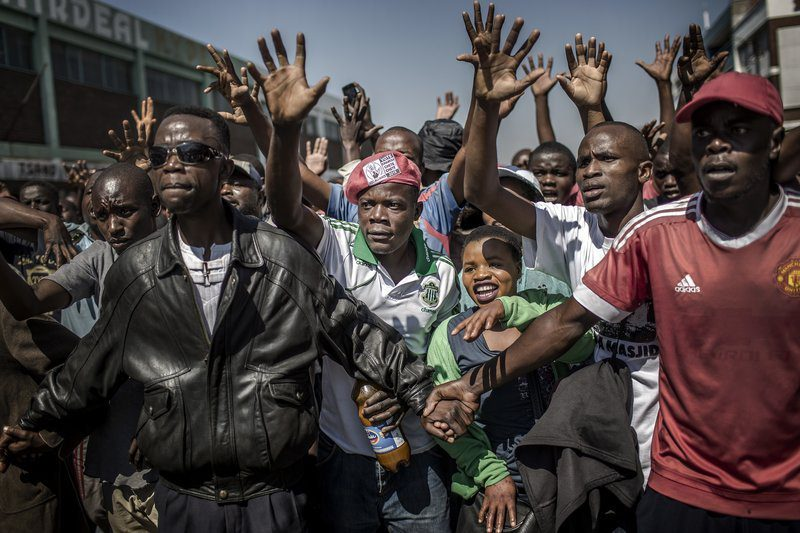 Supporters of the opposition party Movement for Democratic Change (MDC), protest against alleged election fraud in Harare, Zimbabwe on Aug. 1, 2018. Luis Tato—AFP/Getty Images